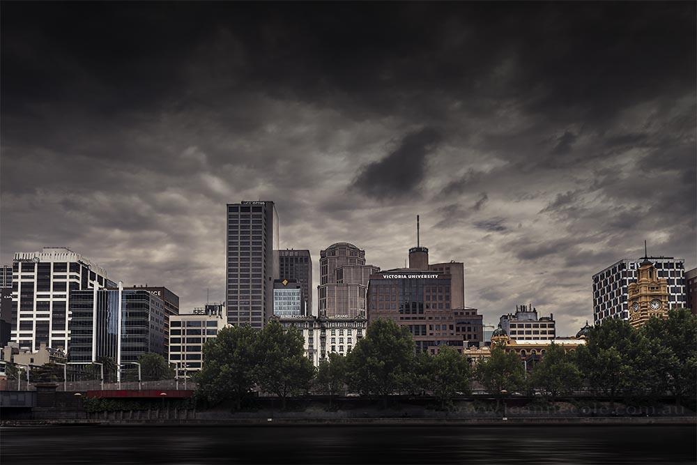 city-skyline-cloudy-moody-river