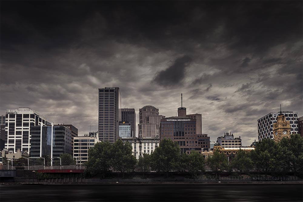 city-skyline-cloudy-moody-river