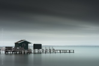 A much longer exposure, around 10 minutes, smooths out the water and blurs the clouds