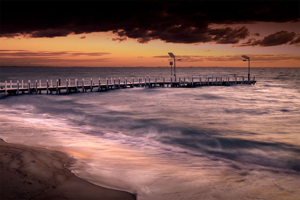 safety-beach-pier-stormy-sunset-1