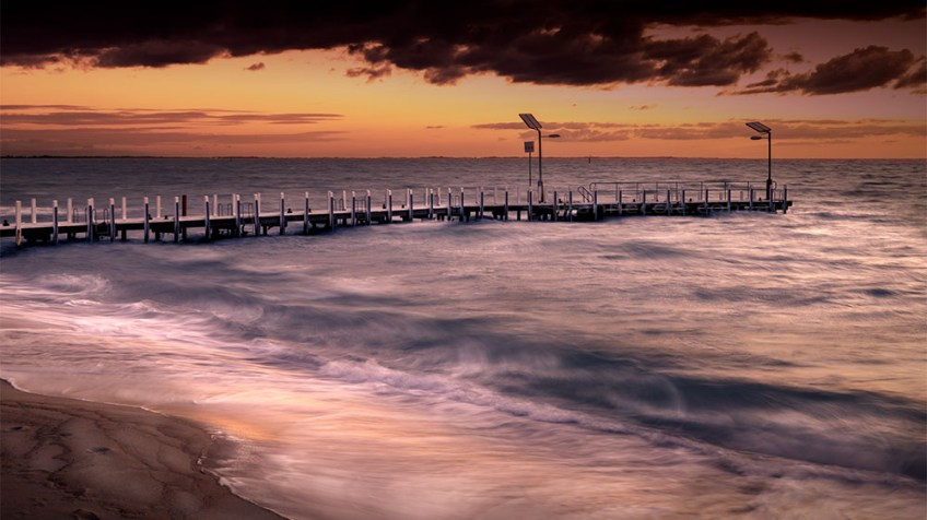 safety-beach-pier-stormy-sunset-1