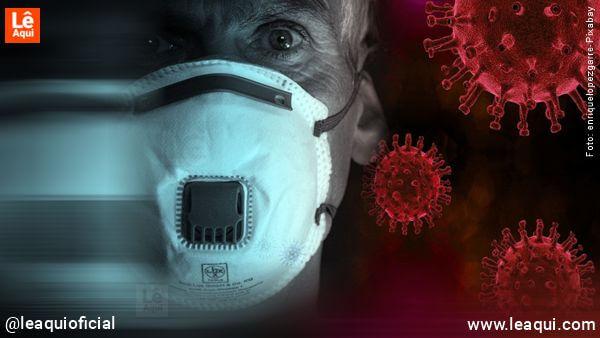 homem com máscara n95 com ilustrações de do coronavírus pesquisas pandemia