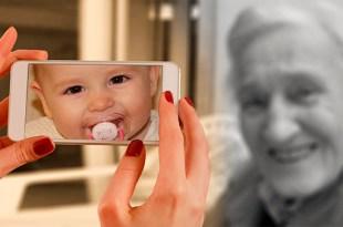 mãos segurando um smartfone para tirar uma fotografia com uma imagem de um bebe no visor e uma velha senhora servindo de modelo tempo precioso