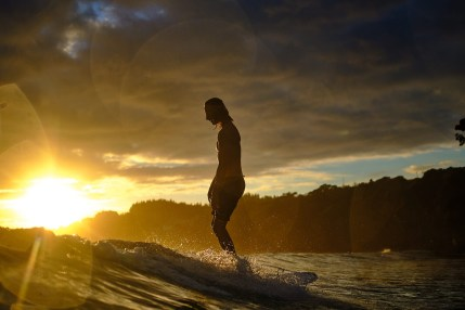 capture one raw image editor russell ord blogpost outline of male sufing low wave at sunset