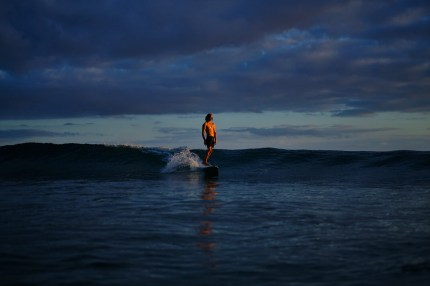 capture one raw image editor russle ord blogpost male riding wave on surfboard at dusk