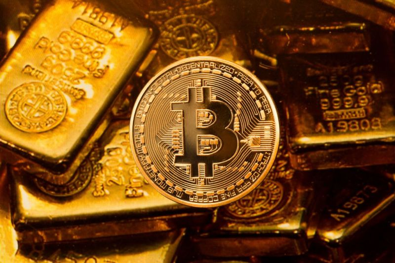 Bitcoin next to gold ignots