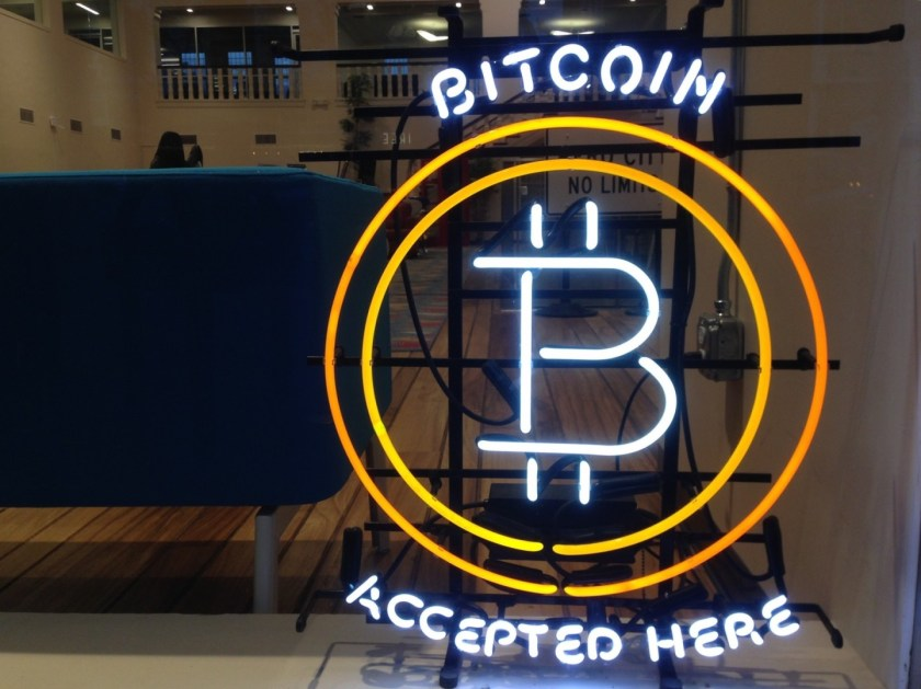 bitcoin accepted here glowing shop front sign