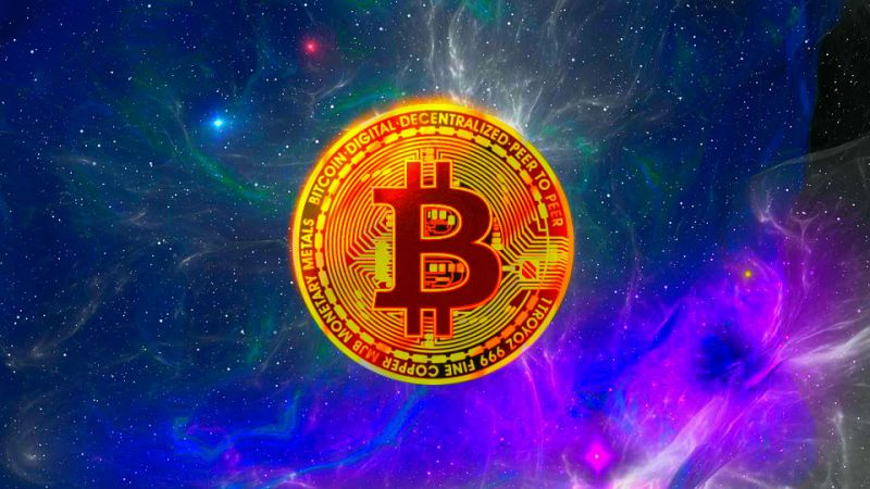 Bitcoin coin in front of a purple and blue galaxy