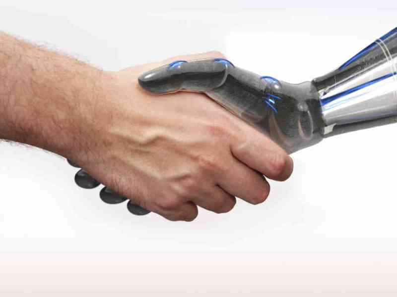 robot and man shaking hands with white background