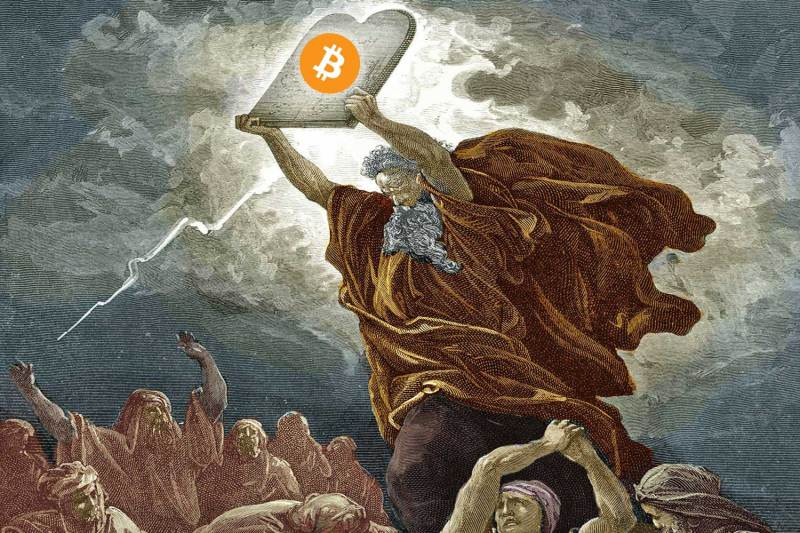 Holy man holding up a bitcoin slate