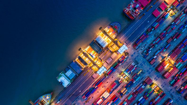 birds eye view of a container ship at a port at night time