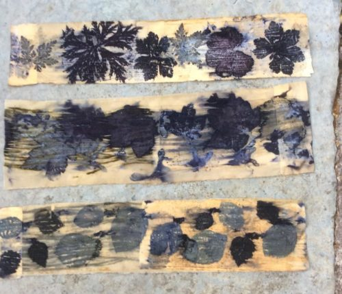 Debbie Lucas: Mixed leaves on cotton wrapped around tin cans