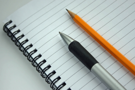 image of a notebook, pen and pencil