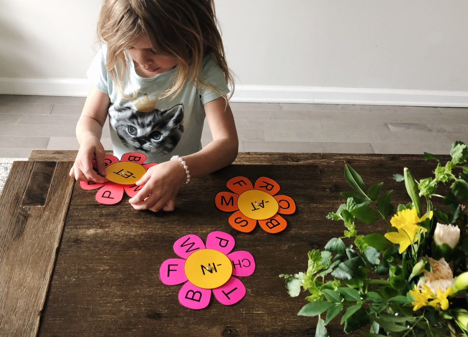 Child working with flower word family cards.