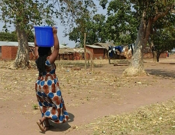 Village life: A woman carrying water