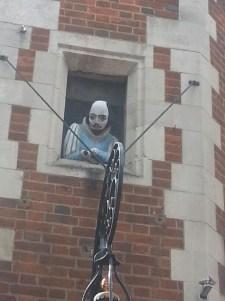Will peeking out the window of Shakespeare's Head Pub on Carnaby Street
