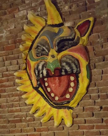 A magnificent papier-mâché mask hanging in the lobby and dining area of the Hotel Florita.