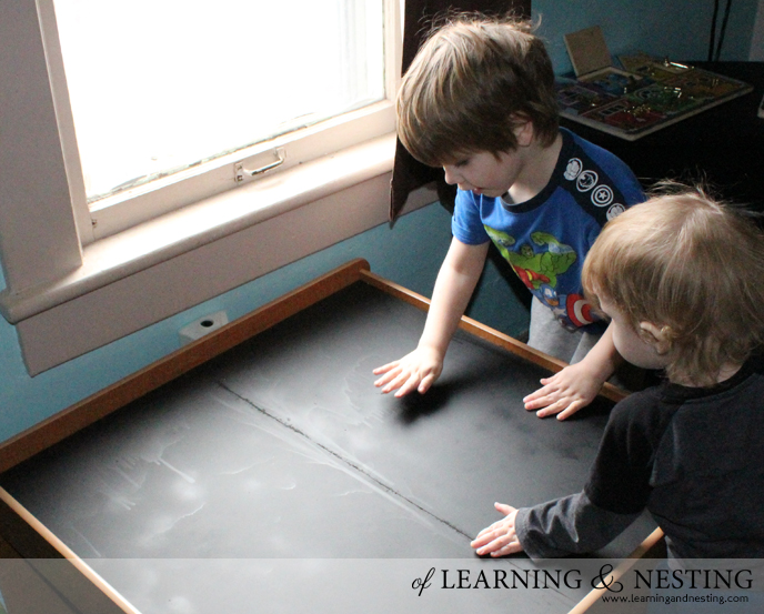 storing things can be easy! We updated this old train table by turning it into a chalkboard train table.