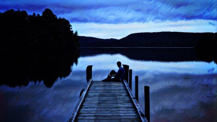 hombre pensando lago nueva zelanda