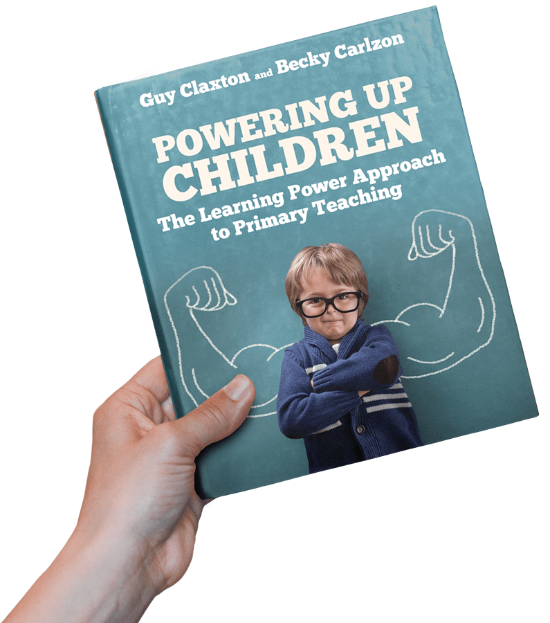 Hand holding book - Powering Up Children