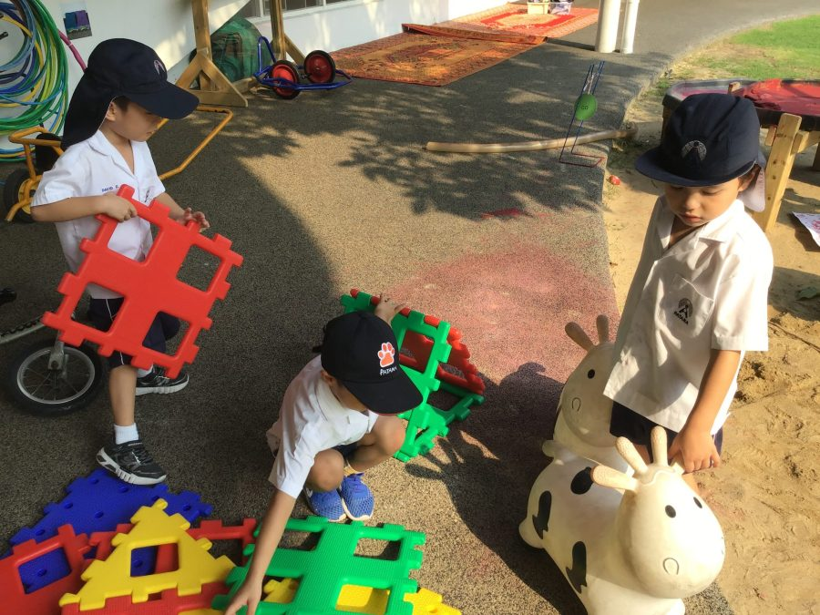 Children collaborating to build a police station
