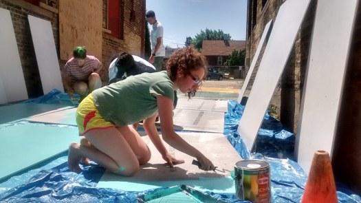 Students priming mural panels.