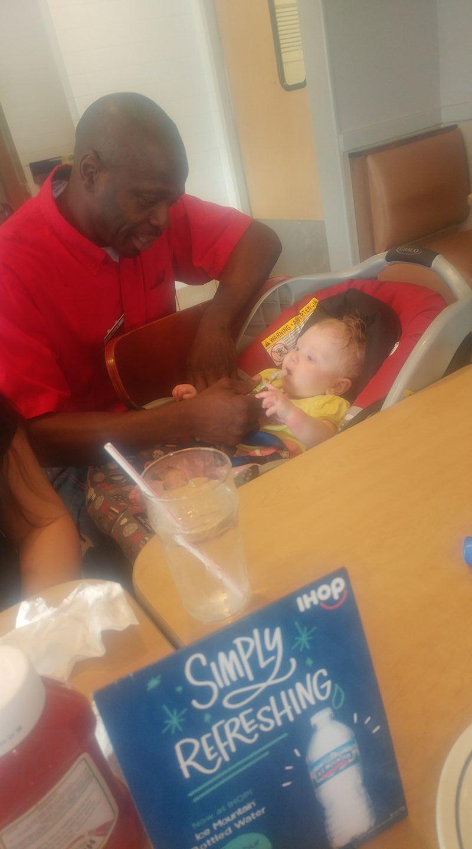 Joe Thomas IHOP Feeding Baby Learn Laugh Love Live Life LRN LAF LUV LIV