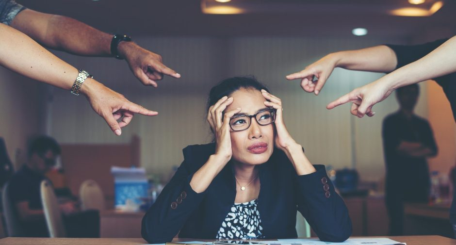 Frustrated business woman sitting at the table in office.
