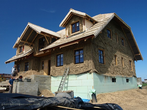 strawbale house with jerkenhead roof and gable dormers