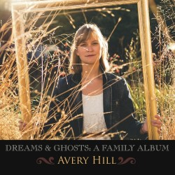 Avery sits in a field of golden grass inside a gold picture frame.