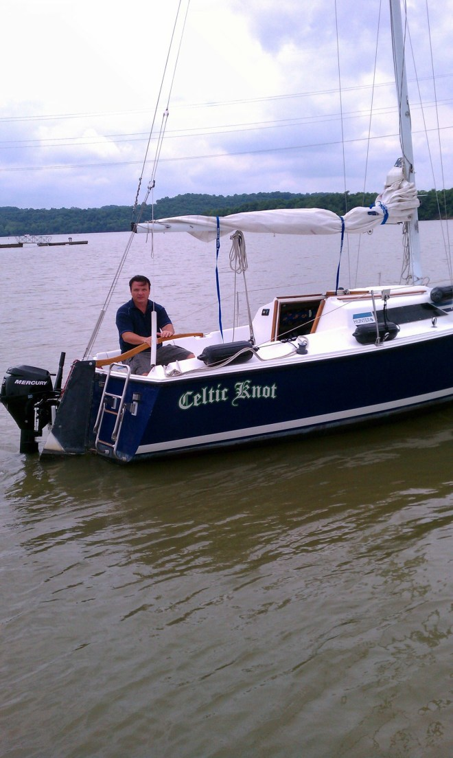 "Our first sailboat....a Hunter 23...I'm not sure why I look so angry in this picture...maybe it was my ""pirate face"""