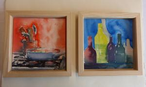 Two framed still-life paintings