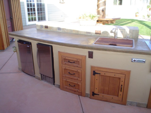red wood storage drawers and doors, with ice maker and mini frig
