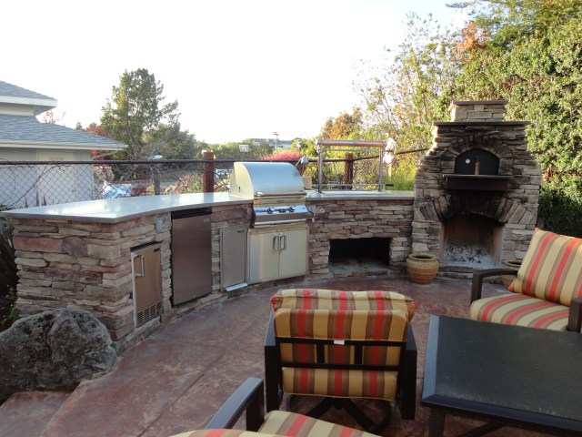 custom arched outdoor kitchen, w/ fire magic appliances and leasure