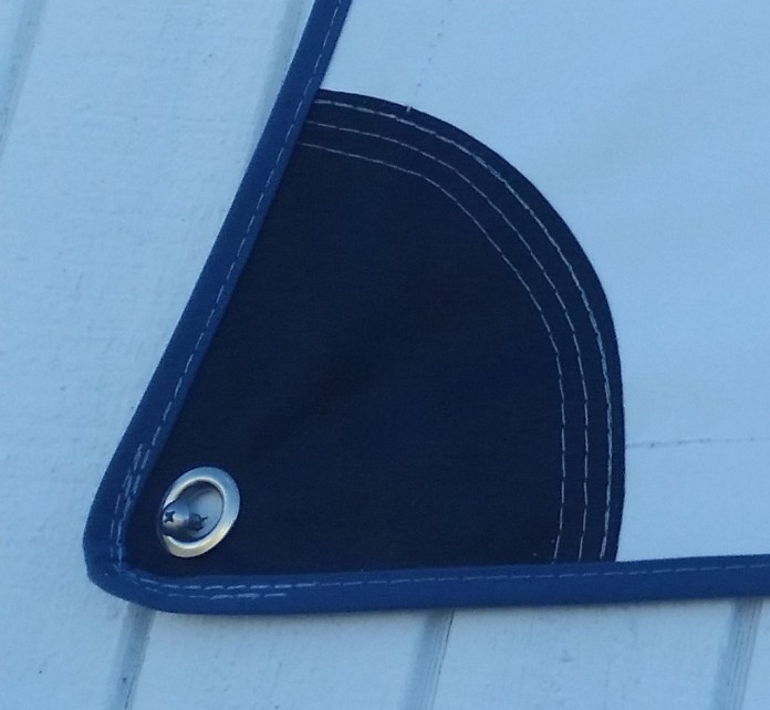 Corner grommet in industrial fabric