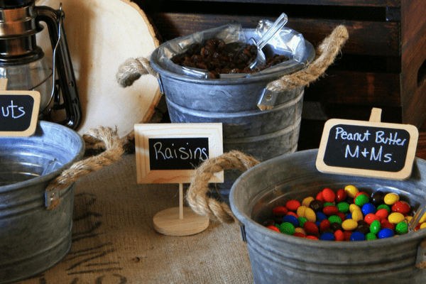 Trail Mix Snack Bar with M&Ms and Raisins at my son's Outdoor Adventure Birthday Party. Take a look at the details at LeavenworthAdventures.com