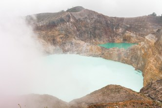 The summit of the Kelimutu crater is lost in the clouds