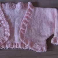 Mini-boléro rose pâle pour fillette