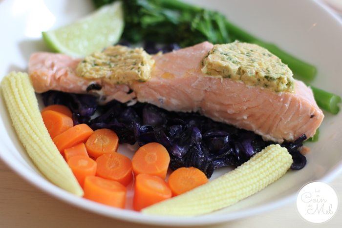 Salmon with Lime and Ginger Butter on a bed of Roasted Cabbage served with Steamed Vegetables