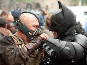 "(L-r) TOM HARDY as Bane and CHRISTIAN BALE as Batman in Warner Bros. Pictures' and Legendary Pictures' action thriller ""THE DARK KNIGHT RISES,"" a Warner Bros. Pictures release. TM and © DC Comics"