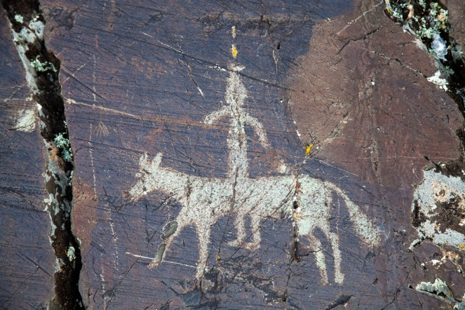Petroglyphs of forts men riding horses, dated from 3,500 BC