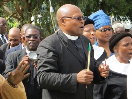 Rev. F. Sekulisa leading the faithful