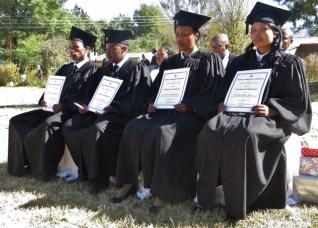 Graduates with their diplomas