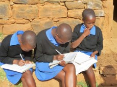 Working on assignments at Qiloane Primary School