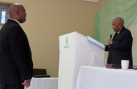 Rev. Masemene (left) takes the Moderator's oath from Rev. Thebe