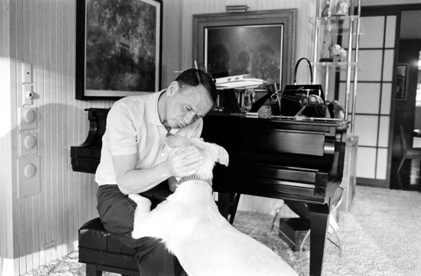 Frank Sinatra and his dog, Ringo, at Sinatra's home in Palm Springs, California, in 1965