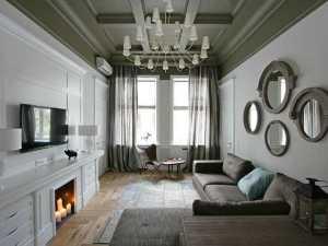 Классический дизайн в мягких серых тонах с камином