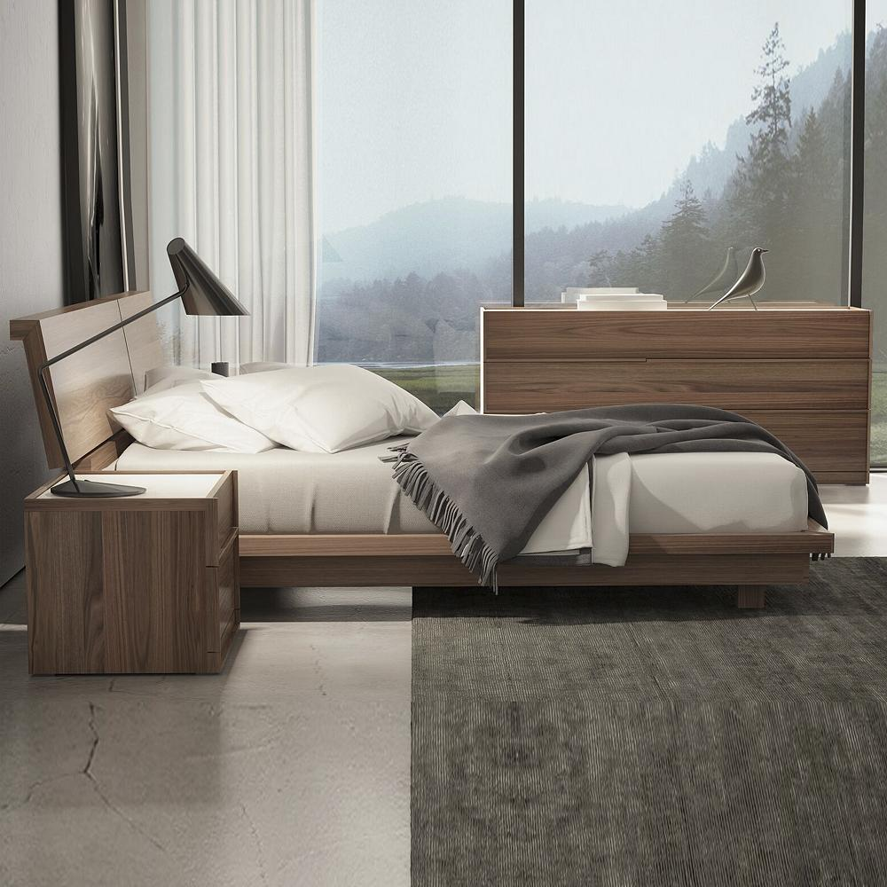 modern low bed with matching nightstand and dresser.