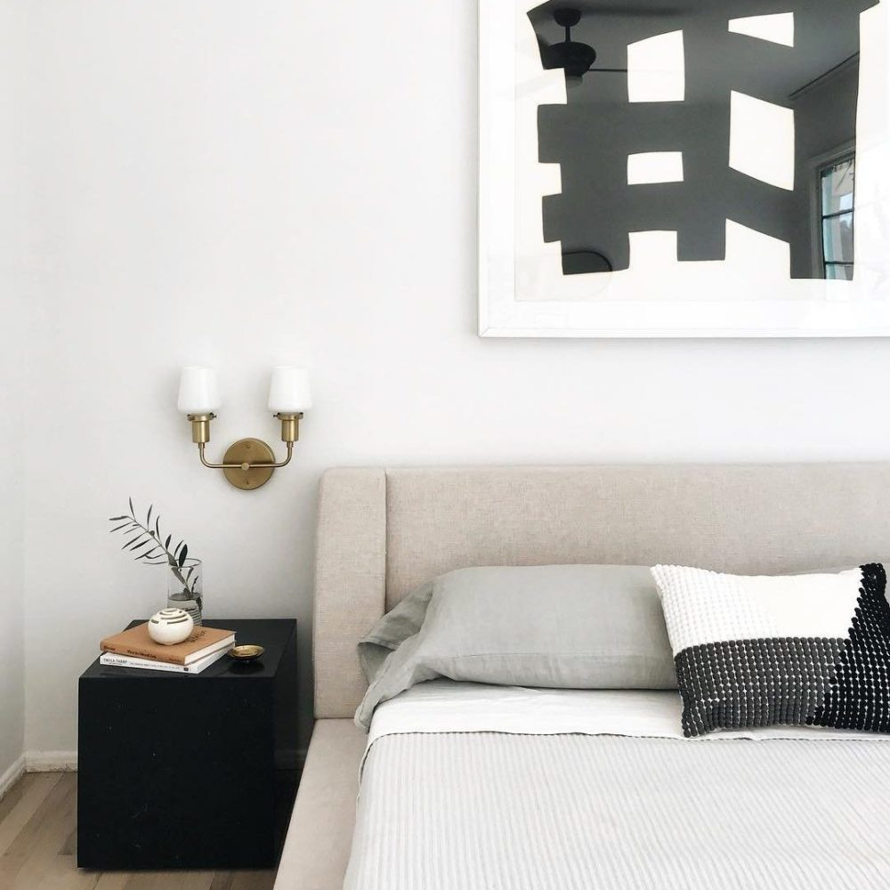 modern and minimal bedroom with wall sconces.
