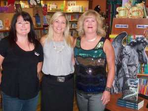 In the middle is store owner Susan Chamberlain and staff member.